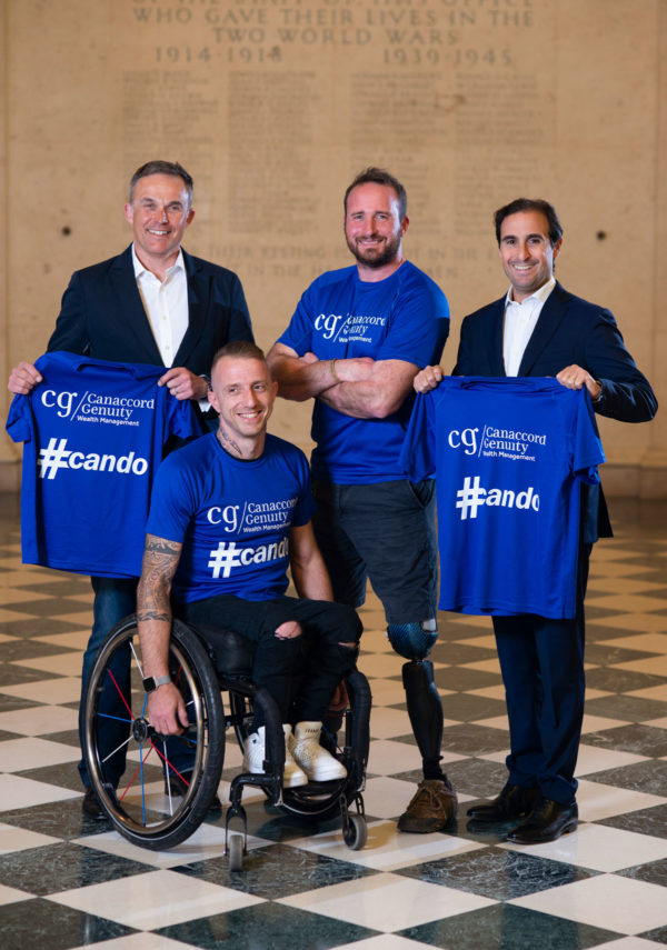 Two disabled athletes with two businessmen